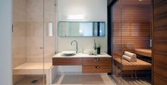 Sublimely Simple - Contemporary Kitchen and Bathroom in light blond Maplewood gloss cabinetry. Home Steam Room, Japanese Soaking Tubs, Sauna Design, Light Colored Wood, Outdoor Bathrooms, Spa Rooms, Bathroom Spa, Home Spa, Custom Cabinetry