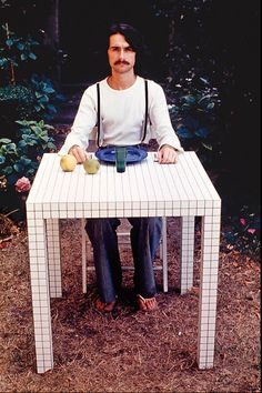"A self-portrait by di Francia with a prototype table from Superstudio's Quaderna furniture series, 1970.  Cristiano Toraldo di Francia, ""Self-portrait (On Misura table),"" 1970/Photo: Archive Cristiano Toraldo di Francia."