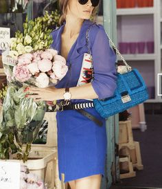 Not sure i like the whole effect but the elements are all right - sheer shirt, men's watch, gold chain, great colour blue skirt, peony roses...