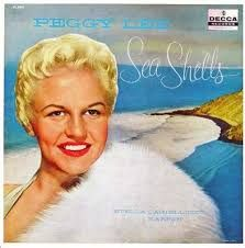 1920 - 2002 Sea Shells is a 1957 album by Peggy Lee, recorded in early 1955 between  7 Feb and 31 Mar 1955. The album was possibly thought by her record company to be too esoteric, hence its later release. It was her last recording for Decca Records. The album is considered one of Miss Lee's more personal records, featuring a mix of love ballads and poems. She is accompanied only by harp played by Stella Castellucci  and harpsichord. Peggy also wrote her own liner notes for the release