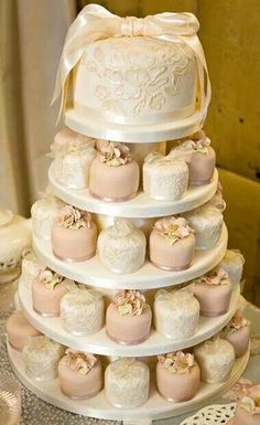 The Latest Wedding Trend: 50 Individual Wedding Cakes Along with wedding mini desserts trend, there's another one for individual cakes. Why worrying about one or two big cakes that would suit everyone when you can order a whole bunch… Individual Wedding Cakes, Mini Wedding Cakes, Individual Cakes, Wedding Cakes With Cupcakes, Mini Cakes, Cupcake Cakes, Wedding Desserts, Pink Cupcakes, Vintage Wedding Cakes