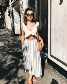 cute two piece top with white ruffles and flow striped pants