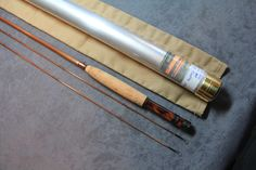 R. D. TAYLOR ROD CO. - MAKERS, NY MODEL 23-4-401, 6 1/2' 2PC 2 TIP 4 WT, Medium fast dry fly action. Bob's flamed tone model. Blued nickel silver ferrules. Wrapped in brown silks and tipped in red. Agate stripper guide with cigar cork grip and blued nickel silver slideband reelseat and Walnut wooden spacer.
