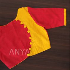 Pleated sleeve end with a cloth button makes this simple design stand out!Get yours customized today! Cotton Saree Blouse Designs, Kids Blouse Designs, Simple Blouse Designs, Stylish Blouse Design, Blouse Neck Designs, Neck Designs For Suits, Kurta Neck Design, Delicate, October