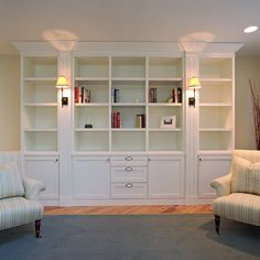 This is the style bookcase I would love to build for this room - Bookshelf plans