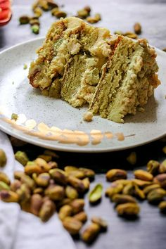 The Momofuku milk bar pistachio layer cake is filled with layers of dense and decadent pistachio cake, light lemon curd, rich pistachio frosting, and buttery milk crumbs. It is truly a masterpiece! Food Cakes, Cupcake Cakes, Gourmet Cakes, Momofuku Milk Bar, Pistachio Cake, Pistachio Paste Recipe, Pistachio Cheesecake, Cake Recipes, Dessert Recipes