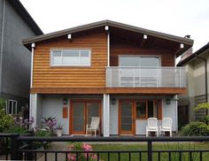Dating back to the late and then mass produced in the the Vancouver Special design is iconic. An estimated Vancouver Specials were. Container House Design, Tiny House Design, Exterior Colors, Interior And Exterior, Exterior Paint, Filipino Architecture, 2 Storey House, Balcony Railing, Home Reno