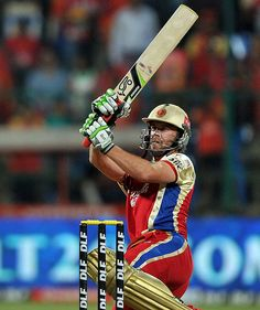 Royal Challengers Bangalore (RCB) batsman AB DeVilliers scores a boundary during the IPL cricket match between Royal Challenger Bangalore and Deccan Chargersat the M. Chinnaswamy Stadium in Bangalore on May Cricket Videos, Cricket Score, Live Cricket, Cricket Match, Cricket News, Ab De Villiers Photo, Cricket Update, Dhoni Wallpapers, Cricket Wallpapers