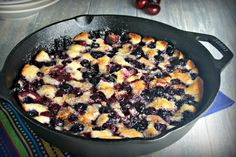 Cast Iron Cherry-Berry Cobbler,a fruit-filled old-fashioned cobbler baked right on your grill inside a BakerStone Pizza Oven Box. #sponsored