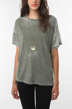 Casual going out top paired with black jeans, black boots, gold jewelry.