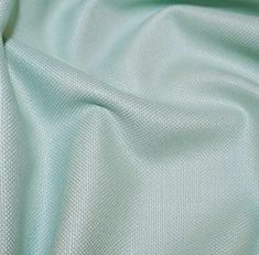 Between mint green and light green this cotton canvas, medium weight, A great fabric for creating bags, craft items, with a lovely feel and drap Width (cm): 140 Width (inch): 55 Wash: 30 degrees Iron: medium Tumble dry: low Do not bleach.