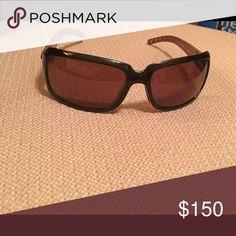 Costa Del Mar sunglasses Costa Isabela sunglasses with polarized glass lenses, copper in color, and black/pink fade frames. Look brand new. Costa sunglass case included. Accessories Sunglasses