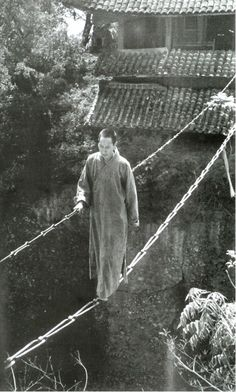 The Jiangyou Figure Hill Temple. Simple iron chain bridge, China, 1930s