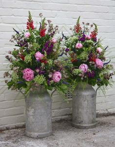 So pretty, love all the colors, but not sure if that would work for my front step.  milk churns for flowers - Google Search
