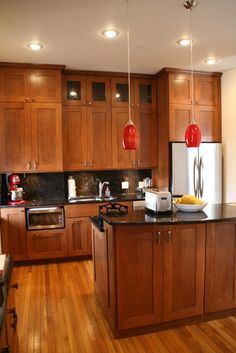 maple shaker cabinets - similar to our new ones but a liiiitttttllllleee fancier... :-)