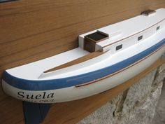"""* This is the 24"""" half hull model of the Valiant 40 sailboat.  The model is mounted on the Teak backboards. The size of the backboard is 30"""" x 11"""". The model weight is 10 LBS. ................. Please contact Mas at halfhull@gmail.com or visit the web at www.halfhull.net for more model information. Zuma Boat (404) 272-7889."""