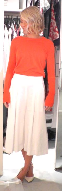 Kelly Ripa in Rebecca Taylor white culottes and J. Crew neon orange sweater. LIVE with Kelly and Michael Fashion Finder