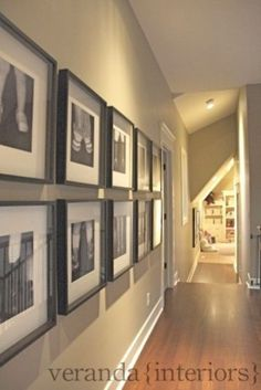 """Love that these photos are """"hung"""" off a horizontal mid point."""