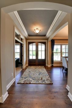 Hanson Builders, Inc. | Property Detail  what a great entry!  Love the rug