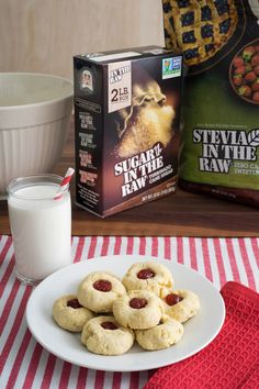 Add these homemade Holiday Thumbprint Cookies made with Sugar In The Raw® and Stevia In The Raw® to the top of your Christmas baking list! These traditional cookies are only 100 calories and filled with a tasty strawberry jelly making them a must-bake recipe for any cookie swap you attend this season.