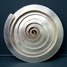 Spiral silver brooch by Debbie Long