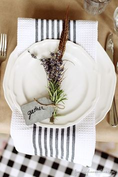 Thanksgiving Table Setting with bar towels, herbs, twin and feathers. 4 Inspirational Themes for Your Thanksgiving Table from StyleBlueprint.com