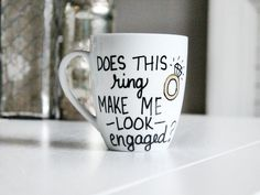 Does This Ring Make Me Look Engaged Mug- engagement mug- engagement announcement- does this ring make me look engaged-bride to be, funny mug by Brusheswithaview on Etsy https://www.etsy.com/listing/246665745/does-this-ring-make-me-look-engaged-mug
