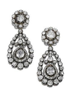 PAIR OF DIAMOND EAR PENDANTS, 19TH CENTURY.  Each surmount of cluster design to a pear-shaped drop pendant with swing centre set with circular-cut, cushion- and pear-shaped diamonds, mounted in cut-down collets, later post and butterfly fittings, surmounts detachable, composite.