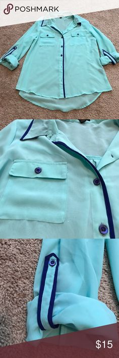 Sheer Teal Button Up Blouse Sheer Teal Button Up Blouse with Royal Blue Accents. Sleeves roll up or down. Great for Business Attire. Smoke Free Home Tops Blouses