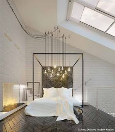 Wood herringbone floors, white painted brick fireplace and those lights over the modern steel four poster bed - HEAVENLY!
