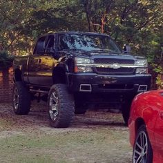 Love it!!! Lifted Black Chevrolet Silverado with Bow-Tie