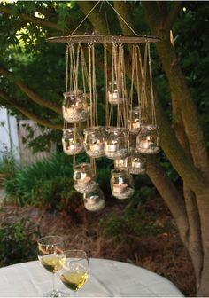 Here's a simple DIY garden chandelier tutorial from Ecologue. It's a great way to reuse little glass jars you may already have at home. food ideas cheap mason jars 8 Genius Ways to Recycle Baby Food Jars Lustre Exterior, Outdoor Chandelier, Chandelier Ideas, Hanging Chandelier, Diy Candle Chandelier, Chandeliers, Chandelier Creative, Rustic Chandelier, Backyard Lighting