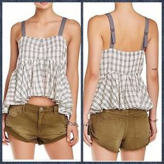 "Windowpane Plaid Lola Tank Top A peplum hem teams with side cutouts, lending feminine flair to this laid-back silhouette. Adjustable contrast straps Sleeveless Cutouts at sides Asymmetrical peplum hem Pullover About 20"" from shoulder to hem Cotton Machine wash Imported Free People Tops Tank Tops"