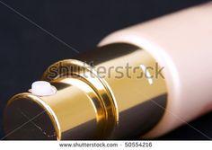 Measuring spray tube on black - stock photo
