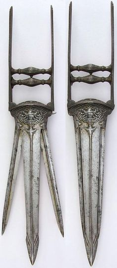 "Indian ""sissors"" katar, 18th to 19th century, L. 19 1/4 in. (48.9 cm); W. 3 3/16 in. (8.1 cm); Wt. 30.5 oz. (864.7 g), Met Museum, Bequest of George C. Stone, 1935."