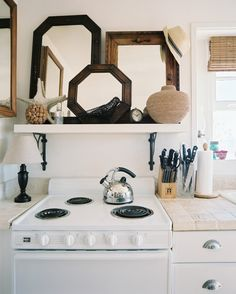 Mirror, Mirror One of our favorite small-room decorating tricks is adding mirrors to give the illusion of space. Here, they do double duty by adding a decorative accent to a kitchen shelf that might otherwise be used for run-of-the-mill cookware.
