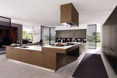 Ideas Modern Kitchen Cabinets Pictures Modern Kitchen Design With Large Area Brown U Shape Island With Whit Granite Top Wooden Refrigerator Beige Porcelain Floor Black Glass Window And Door Dark Gloos Kitchen Cabinet Black Rug 22 Modern Kitchen Trend Layout With Stylish Cabinet Ideas