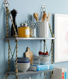 Rope Shelf Could also use kids wooden swing seats from Bunnings. The the holes are already in place. Easy shelving for outdoors.