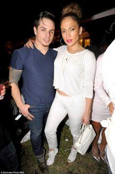 Jennifer Lopez wearing Giuseppe Zanotti Crocodile Embossed Lace Up Peep Toe Booties Chanel 2.55 Bag in White