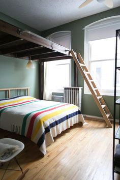 I actually like the idea of a non-lofted bed, but having a loft. The space could be set up for out of season stuff, or, ideally, as a reading and music nook.