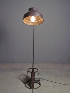 claussen floor lamp | redinfred.com - creative re-use is what vintage does best + the claussen, combining a hat-shaped shade + funky foot work, does it with particular style + panache