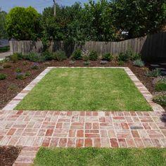 reclaimed red brick paving yard