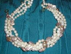 A piece in progress, 17mm mauve Keshi reborn, large pearls will be interlaced with 8mm white fresh water and clasped so it may become a signature piece for dialy use from jeans to whatever. To formalize, 4 strands of 8mm whites are wrapped around to twist into a pearl crush as seen, the mauve pops when in person.