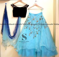 Beautiful lehenga in sky blue color with dark off shoulder blouse in boat neck with embroidery on sleevesand creeper design embroideryon the lehenga.<br>Shaded blue dupatta with gold thread work is really a great combination. Indian Lehenga, Indian Gowns, Indian Attire, Indian Wear, Indian Wedding Outfits, Indian Outfits, Lehnga Dress, Lehenga Gown, Lehenga Designs