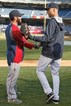 New York Yankees shortstop Derek Jeter, right, greets Boston Red Sox second baseman Dustin Pedroia before a baseball game at Yankee Stadium, Thursday, April 10, 2014.