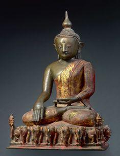 Buddha Sakyamuni seated on an Elephant Pedestal (Gajasana) Myanmar, Ava Kingdom 16th century Bronze, cast in the lost wax method, traces of gilding, inlaid eyes, inscription at the back Height 93 cm