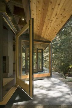 This retreat is essentially a wooden tent on a platform that opens to the forest and river. Tye River Cabin by Olson Kundig Architects Stairway To Heaven, Huge Windows, Windows And Doors, Big Doors, Sliding Windows, Architecture Awards, Architecture Design, Steel Siding, Cabana