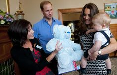 Prince George of Cambridge Royal Playdate  4.9.14 Baby Prince George was the little guest of honor at a special playgroup - his very first public engagement.  Here with his parents, William & Kate, Baby George was presented with a huge stuffed animal