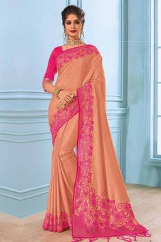 Peach raw silk saree, embellished with beads work, cut work, stone work and resham work. Saree comes with Round Neck, Elbow Sleeve Rose pink raw silk blouse.