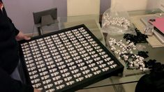 Watch this! 135 minifigurines in a 50x50 Ikea RIBBA frame. This is EPIC.